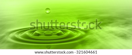 Concept or conceptual green liquid drop falling in water with ripples and waves background banner metaphor to nature, natural, summer, spa, drink, cool, business, environment, rain or health design - stock photo