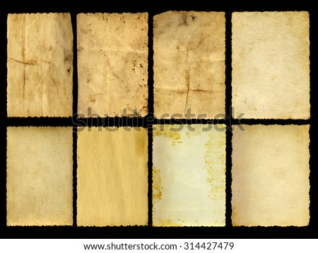 Concept or conceptual old vintage paper background set or collection isolated on black background - stock photo