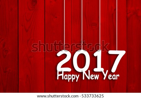 Concept or conceptual old wood or wooden red vintage horizontal December background with 2017 Happy New Year message or greeting, metaphor to holiday, winter, festive, future, hope, wishes, eve design