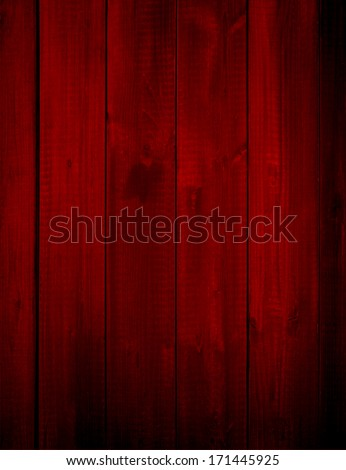 Concept or conceptual red old vintage wooden Christmas or Valentine`s Day plank wood wall background, metaphor to holiday decorative celebration dirty weathered grungy aged xmas happy romantic winter