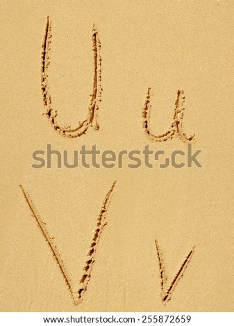 Concept or conceptual sand font or letter set group or collection carved on exotic beach near sea isolated on a sandy background, metaphor to nature, natural, education, character, message or summer - stock photo