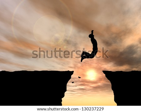 Concept or conceptual young man or businessman silhouette jump happy from cliff over  gap sunset or sunrise sky background as metaphor to freedom,nature,active,mountain,success,free,joy,health or risk - stock photo
