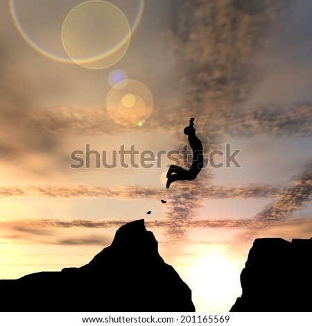Concept or conceptual young man or businessman silhouette jump happy from cliff over  gap sunset or sunrise sky background - stock photo