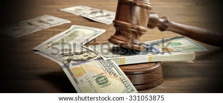 Concept Or Idea For Corruption, Bankruptcy Court, Bail, Crime, Bribing, Fraud, Auction Bidding. Judges or Auctioneer Gavel And Bundle Of Dollar Cash On The Rough Wooden Textured Table Background. - stock photo