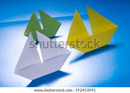 Concept paper navy. Origami model of ships - stock photo