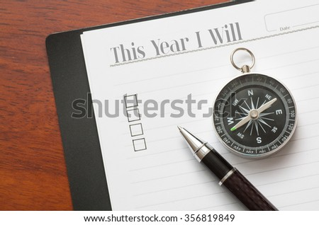 Concept : pen and compass on note book with checklist box on wood background,This year I will phrase. - stock photo