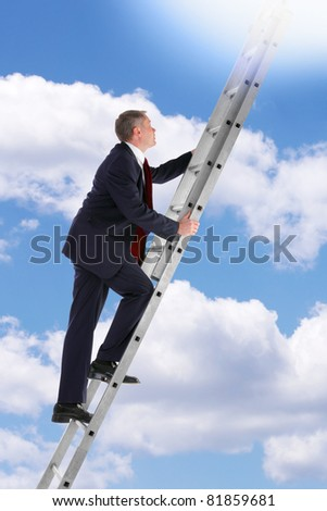 Concept photo of a businessman climbing a ladder into the sky looking up into the light. - stock photo