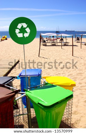 Concept photo of a clean beach with trash separation recycling bags - stock photo