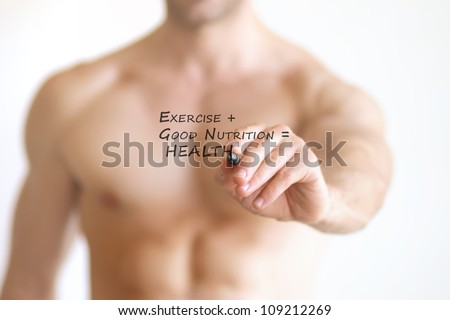 "Concept photo of a fit young shirtless man writing the formula for good health on transparent board that reads ""Exercise + Good Nutrition = Health"" - stock photo"