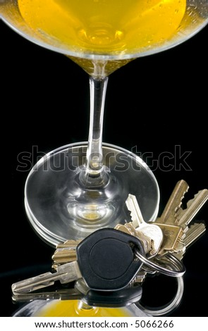 Concept photo of a martini glass and car keys - stock photo