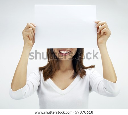 Concept photo of Asian woman holding a white card, covering her eyes. - stock photo