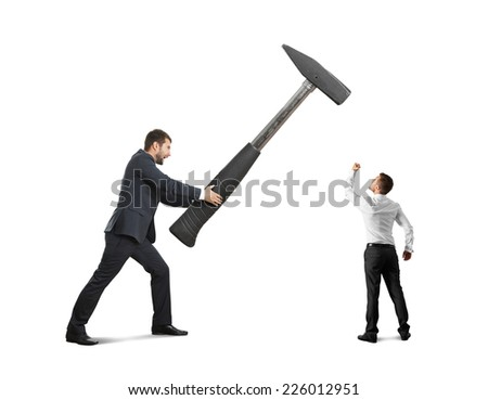 concept photo of conflict between businessmen. small businessman showing fist and looking at big hammer. isolated on white background - stock photo