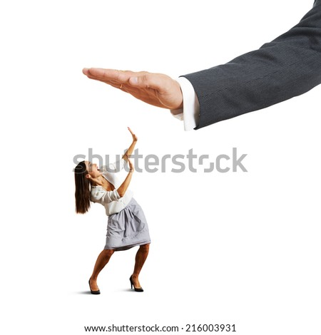 concept photo of conflict between subordinate and boss. startled businesswoman looking up at big palm of his boss and screaming. isolated on white background - stock photo