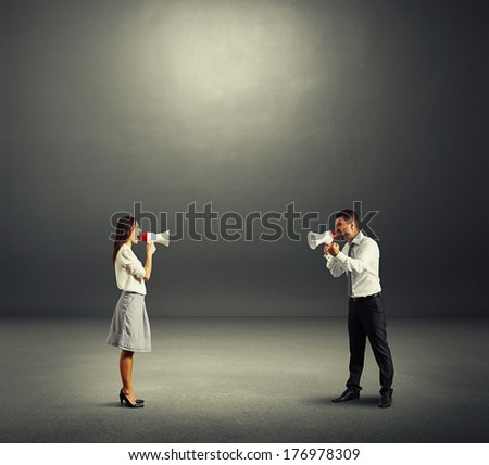 concept photo of quarrel between man and woman over dark - stock photo
