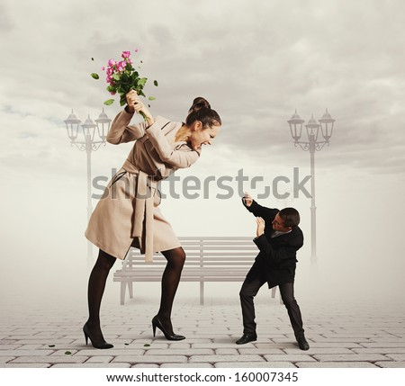 concept photo of quarrel between the man and the woman - stock photo