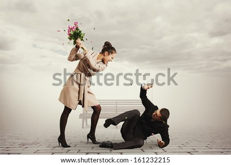 concept photo of quarrel between young man and beautiful woman - stock photo