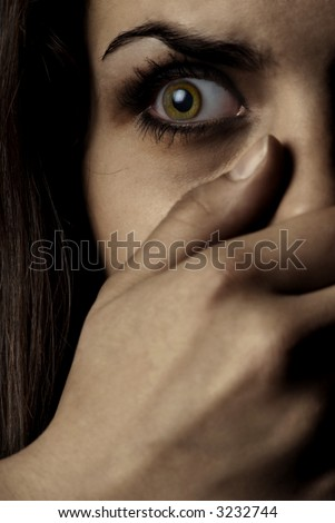 Concept photo of the afraid woman being witness of crime - stock photo