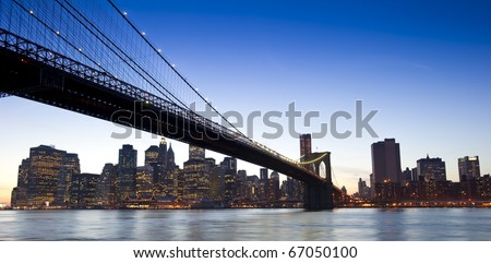Concept photograph of the Brooklyn Bridge and downtown Manhattan at sunset - stock photo