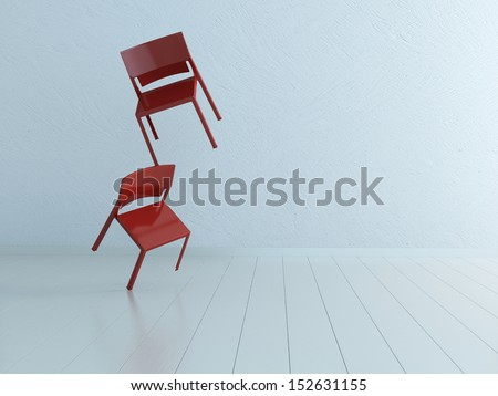 Concept picture of two balancing chairs - stock photo