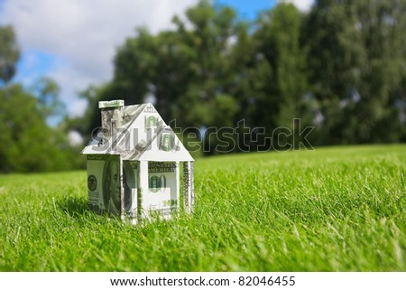 Concept picture on money for new housing - stock photo