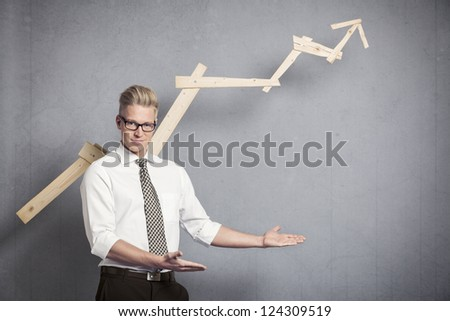 Concept: Positive business outlook. Happy confident businessman presenting or pointing at empty space below business graph with upward trend, isolated on grey background. - stock photo