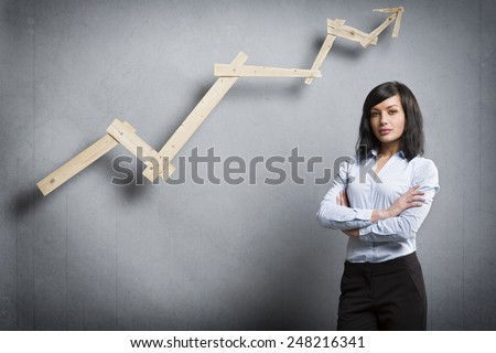 Concept: Positive business outlook. Smiling confident businesswoman in front of business graph with upward trend, isolated on grey background - stock photo