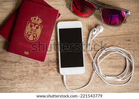 concept prepare for travelling, travel stuff on wooden table, top view - stock photo