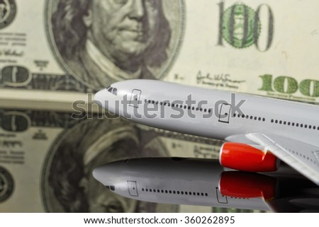 Concept :rise of freight and passenger traffic in the world. Figure the plane on the background of hundred-dollar bills. - stock photo