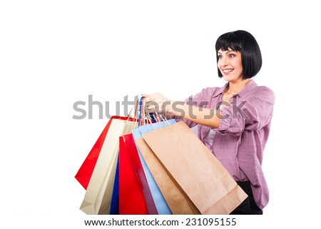 concept sales, brunette woman offering shopping bags, on white background