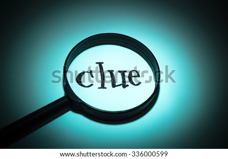 Concept search loupe magnifier clue button - stock photo