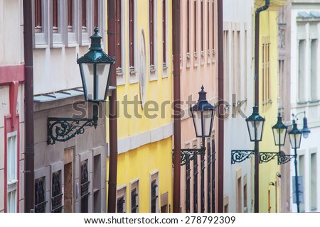 Concept: Selective focus on first street lamp only. Colored beautiful facades with street lamps in Prague Lesser Town, Czech Republic