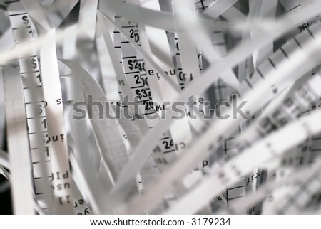 Concept shot for 'Confidential Information' - Shreds papers containing account information, etc. Intentional selective focus shot. - stock photo