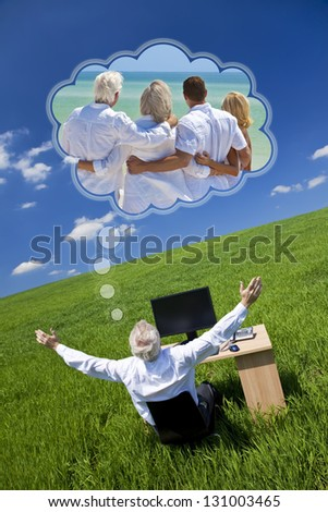 Concept shot of a senior male man executive businessman sitting at work desk in field, arms raised dreaming of tropical family beach vacation holiday or retirement with his wife or girlfriend