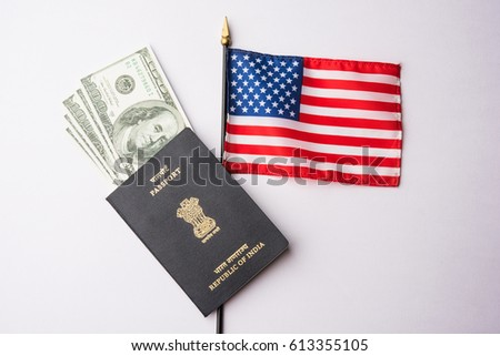 concept showing Indian passport with US currency notes or Dollars with american flag in the background, applying for US / american tourist or H-1B visa