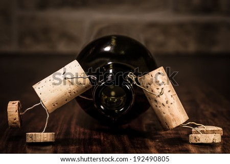 Concept Sickness because too many wine with cork figures - stock photo