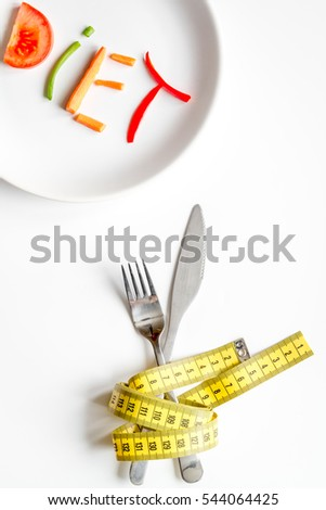 concept slimming diet fresh vegetables on white background top view