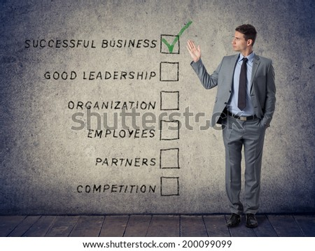 Concept success business, businessman pointing at the main points of a successful business - stock photo