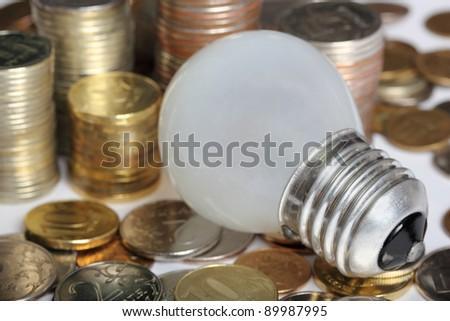concept, symbolizing economic inefficiency of glow lamp - stock photo