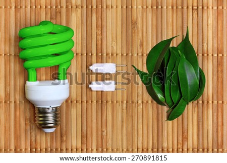 concept, symbolizing the ecological compatibility of energy saving bulbs  - stock photo
