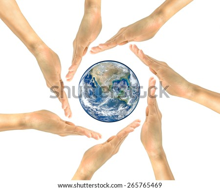 Concept. The hands of people around the inside of which the planet earth NASA. design elements - stock photo