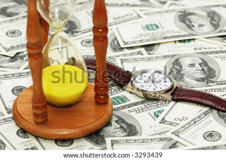 "Concept ""Time is money""  with hourglass and watch - stock photo"