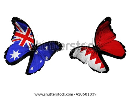 Concept - two butterflies with Australia and Bahrain flags flying