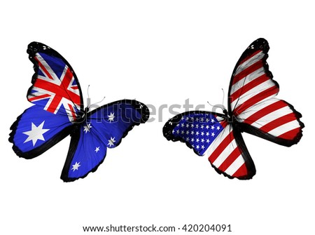 Concept - two butterflies with Australia and USA  flags flying