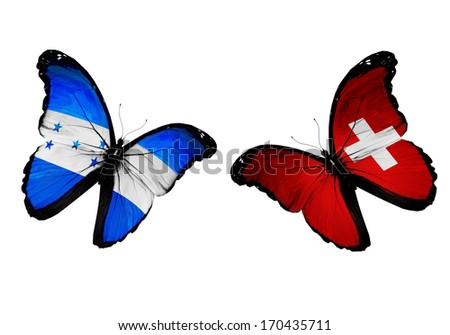 Concept - two butterflies with Honduras and Switzerland flags flying, like two football teams playing - stock photo
