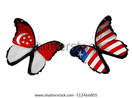 Concept - two butterflies with Singapore and Liberia flags flying