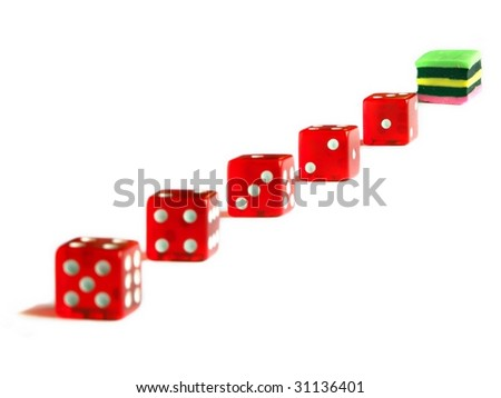 Concept using licorice and dice - it's sweet time,  Focus on licorice and last die - stock photo