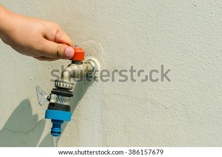 Concept Water Saving. Help preserve water,faucet - stock photo