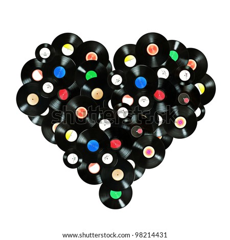"""Concept """"We love music"""" colorful heart shape made of vintage vinyl records, isolated over white background, all labels designed by myself - stock photo"""