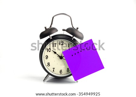 concept with alarm clock and purple time adhesive note - stock photo