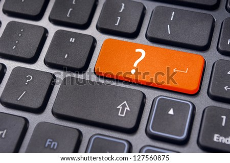 concepts of questions or computer errors, with a question on enter key of keyboard. - stock photo